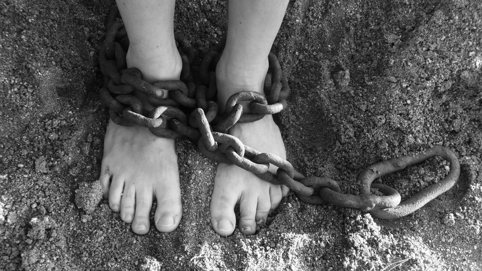 https://pixabay.com/en/chains-feet-sand-bondage-prison-19176/