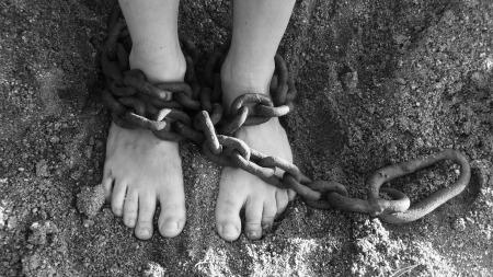 https://pixabay.com/en/chains-feet-sand-bondage-prison-19176/